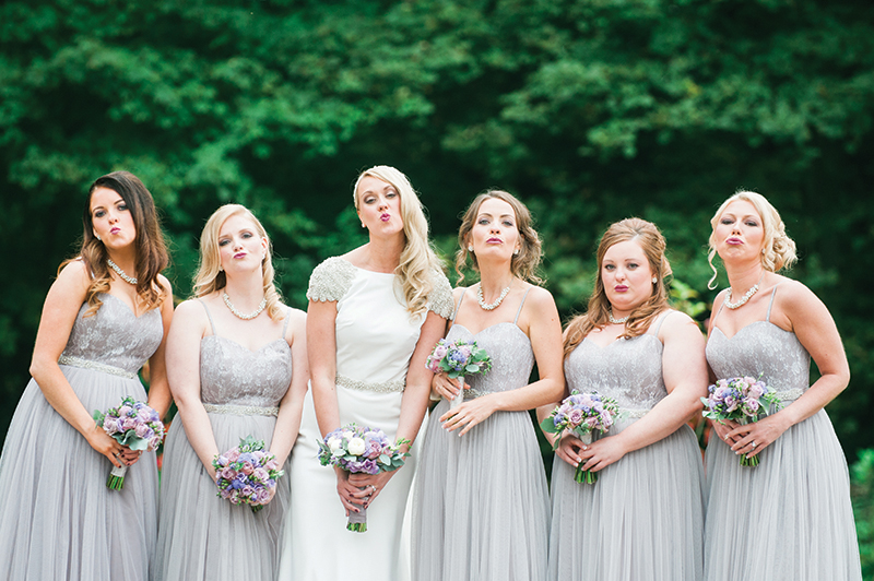 Don't take yourself too seriously. The contrast between the silly faces and the beautiful bridal party makes this image a winner (brownsphoto.co.uk)