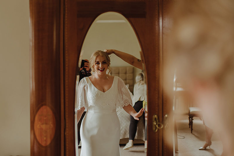 Bride at mirror