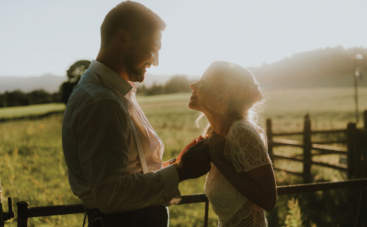 bride and groom in sun