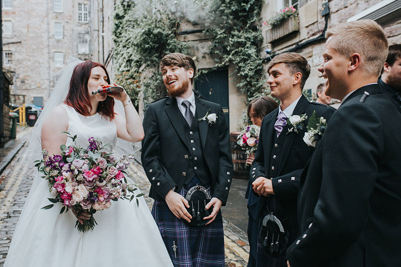 bride drinking from hipflask