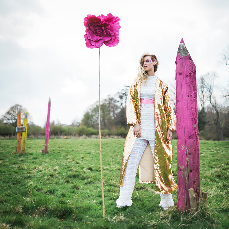 bride standing in field with gold sequin kimono