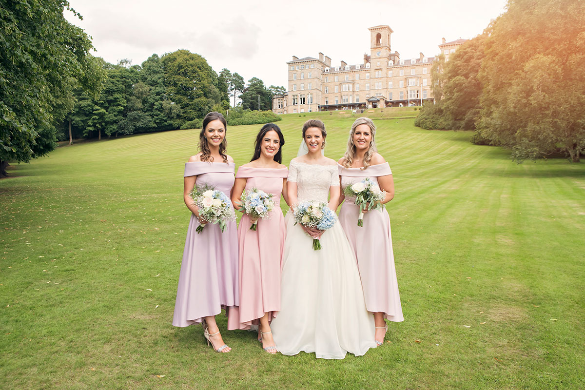 bridesmaids-in-pastel-dresses-outside-dunblane-hydro
