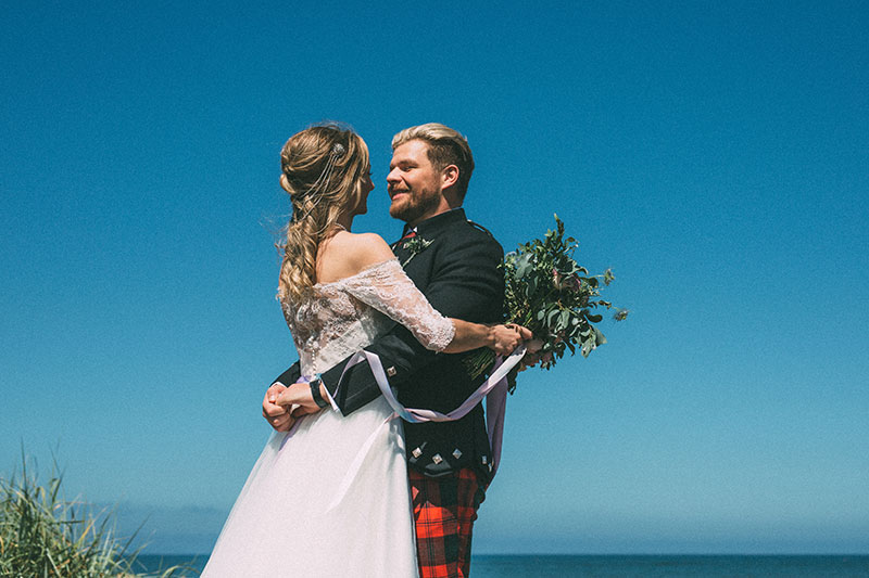 couple having an outdoor ceremony at cambo estate