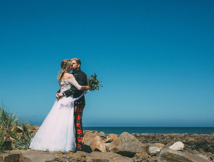 couple standing on the beach at cambo estate
