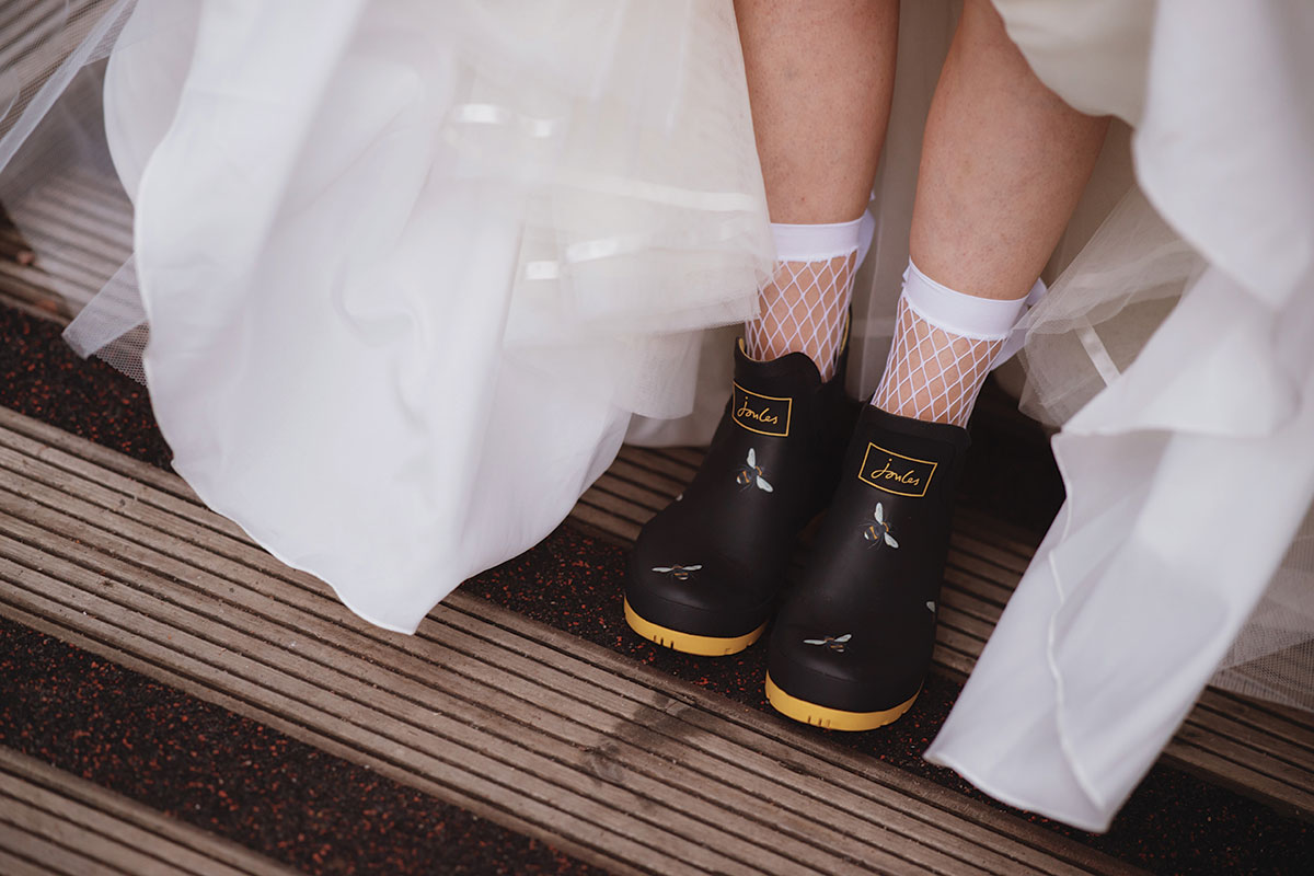 bride-wearing-fishnet-socks-and-joules-wellies