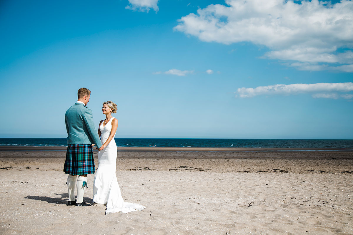 bride-and-groom-on-beach-at-in-Leuchars
