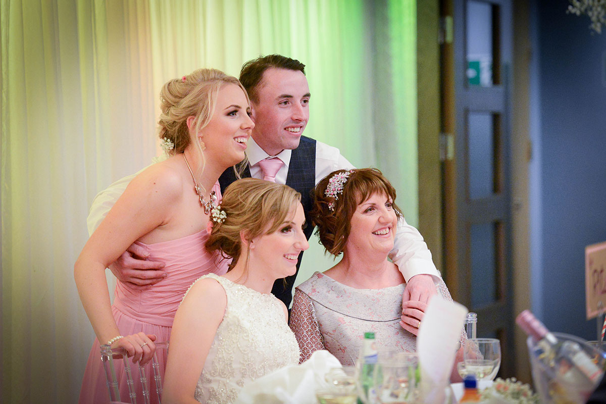 bride-and-family-posing-for-photo