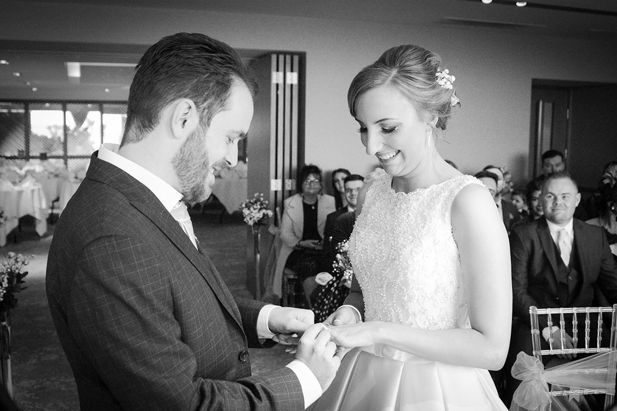 groom-putting-wedding-ring-on-during-ceremony