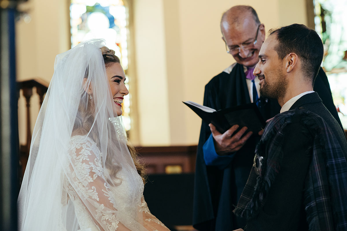 bride-and-groom-laughing-during-the-ceremony