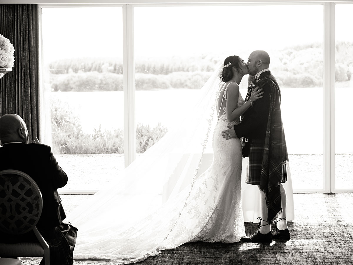 bride-and-groom-kissing-after-ceremony