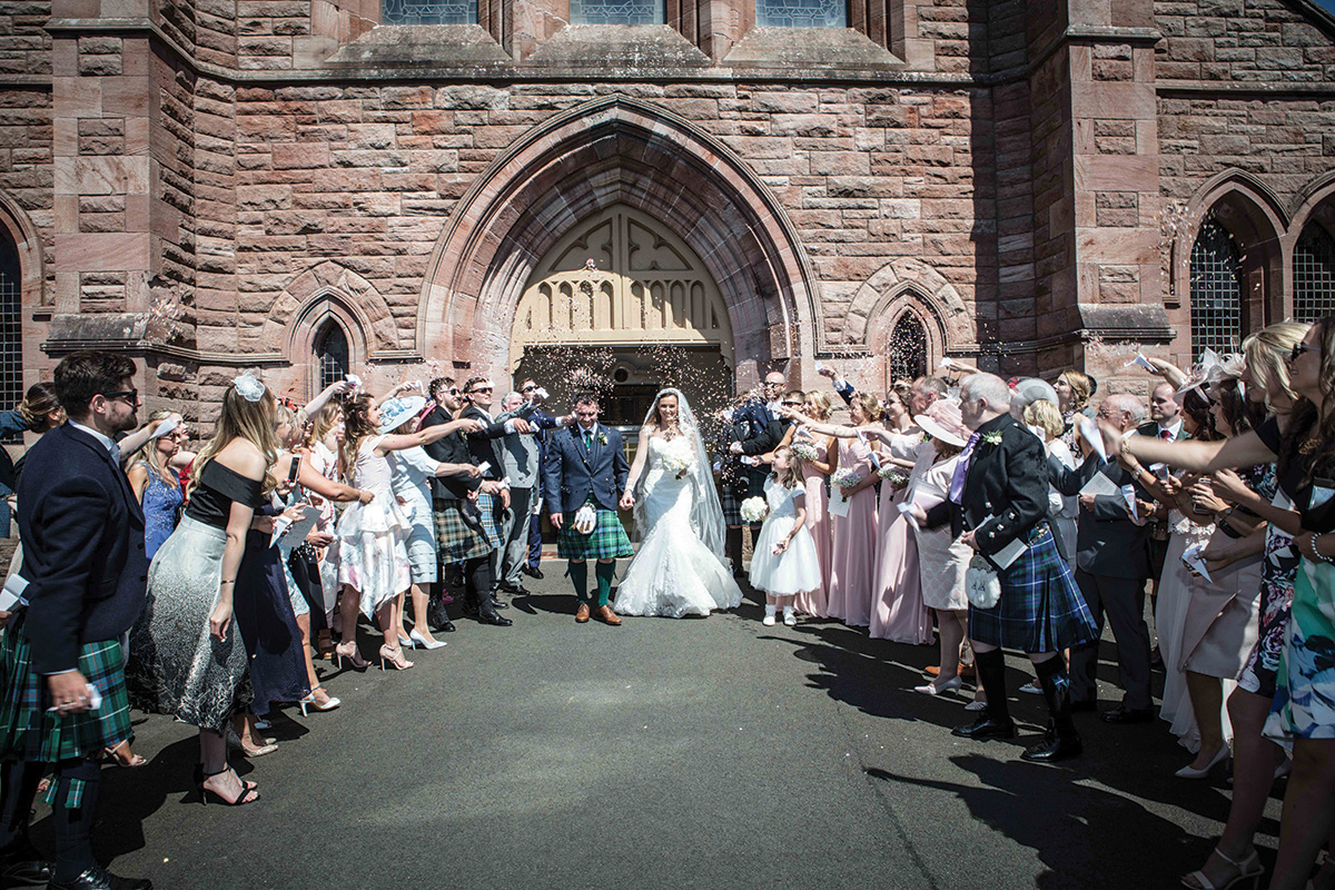 guests-throwing-confetti-on-bride-and-groom