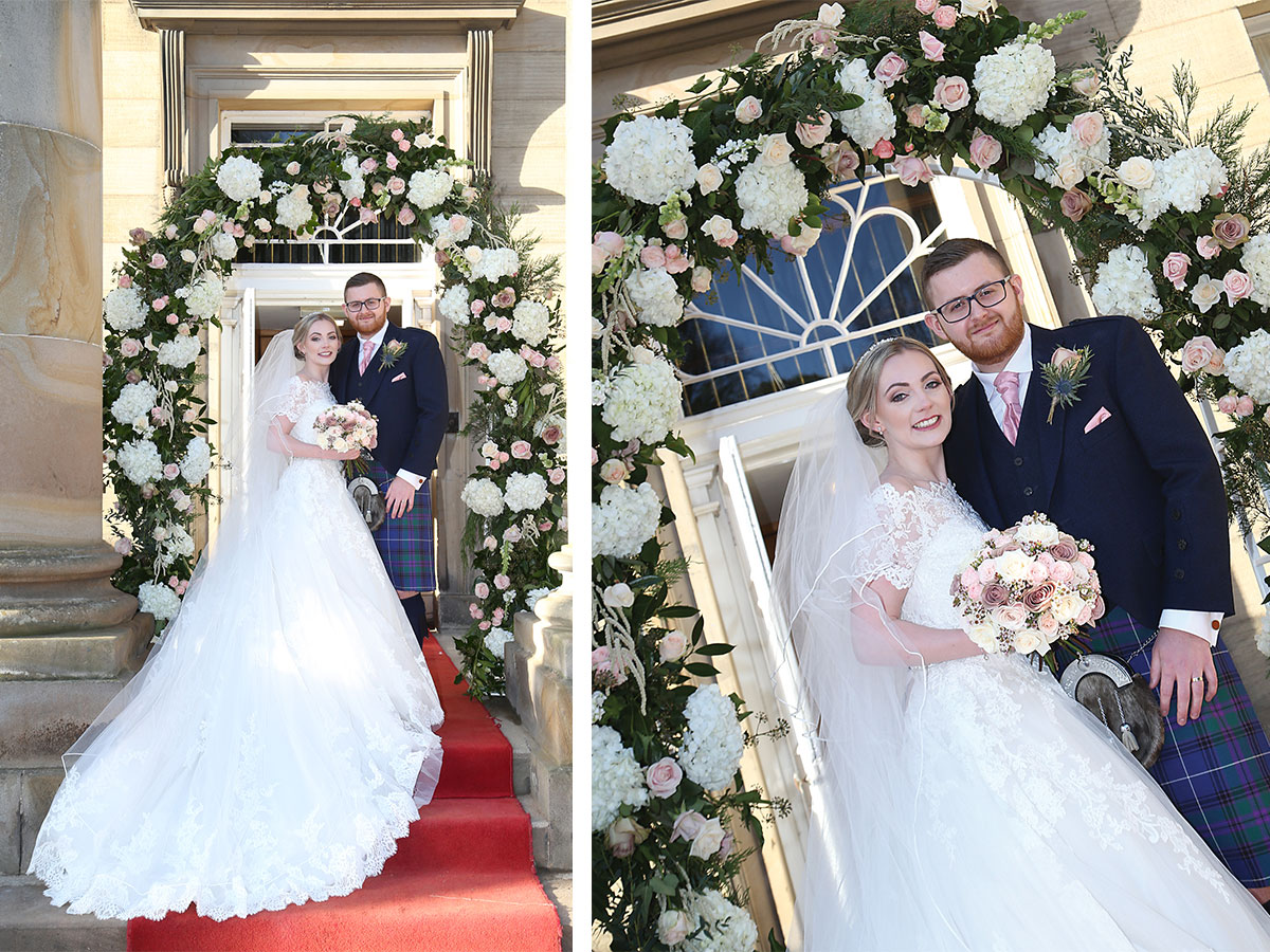 bride-and-groom-under-floral-arch-at-balbirnie-house