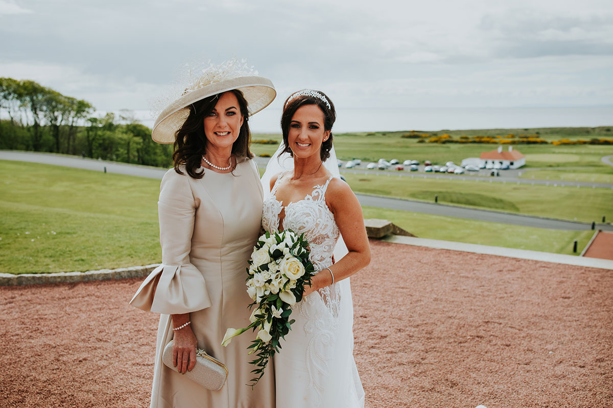 bride-posing-with-mother-of-the-bride-in-light-dress