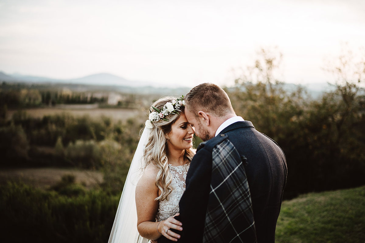 bride-with-floral-crown-and-groom-with-blue-kilt-outfit