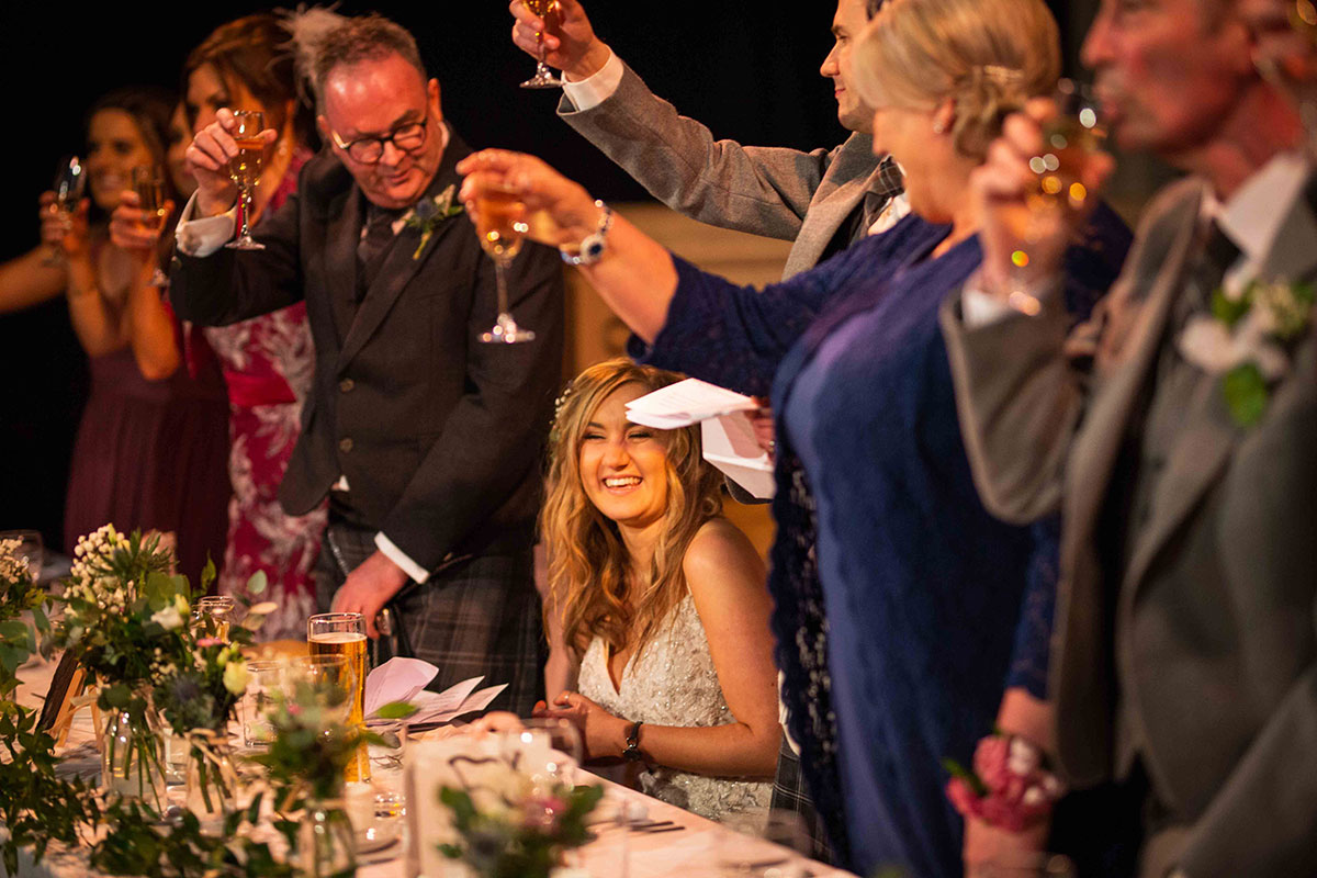 guests-toasting-to-the-bride