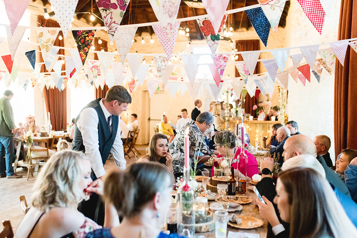 guests-drinking-in-village-hall-filled-with-bunting
