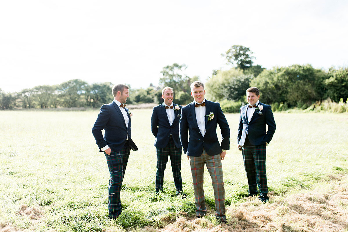 groom-and-groomsmen-in-tweed-suit-jacket-and-tartan-trouser