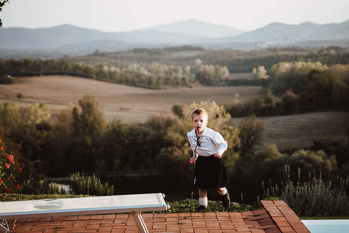 boy-in-kilt-outfit-against-scenic-backdrop