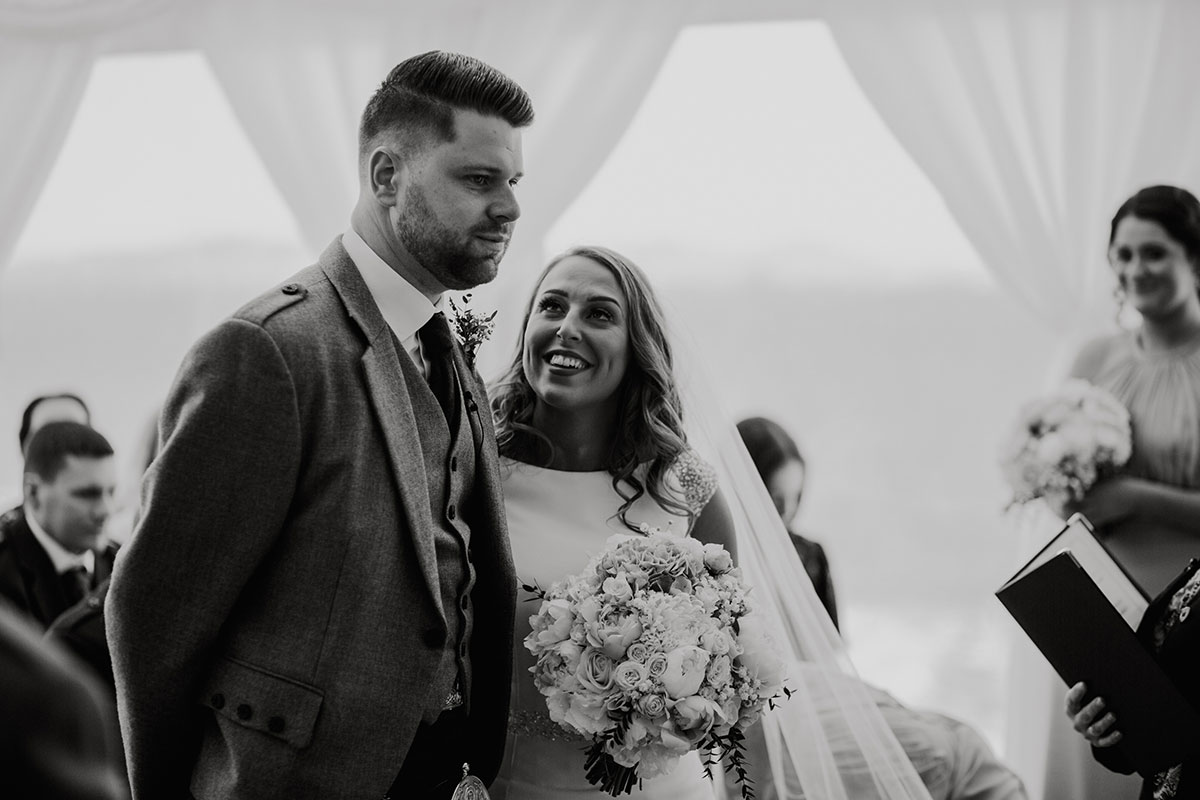 bride-smiling-at-groom-during-ceremony