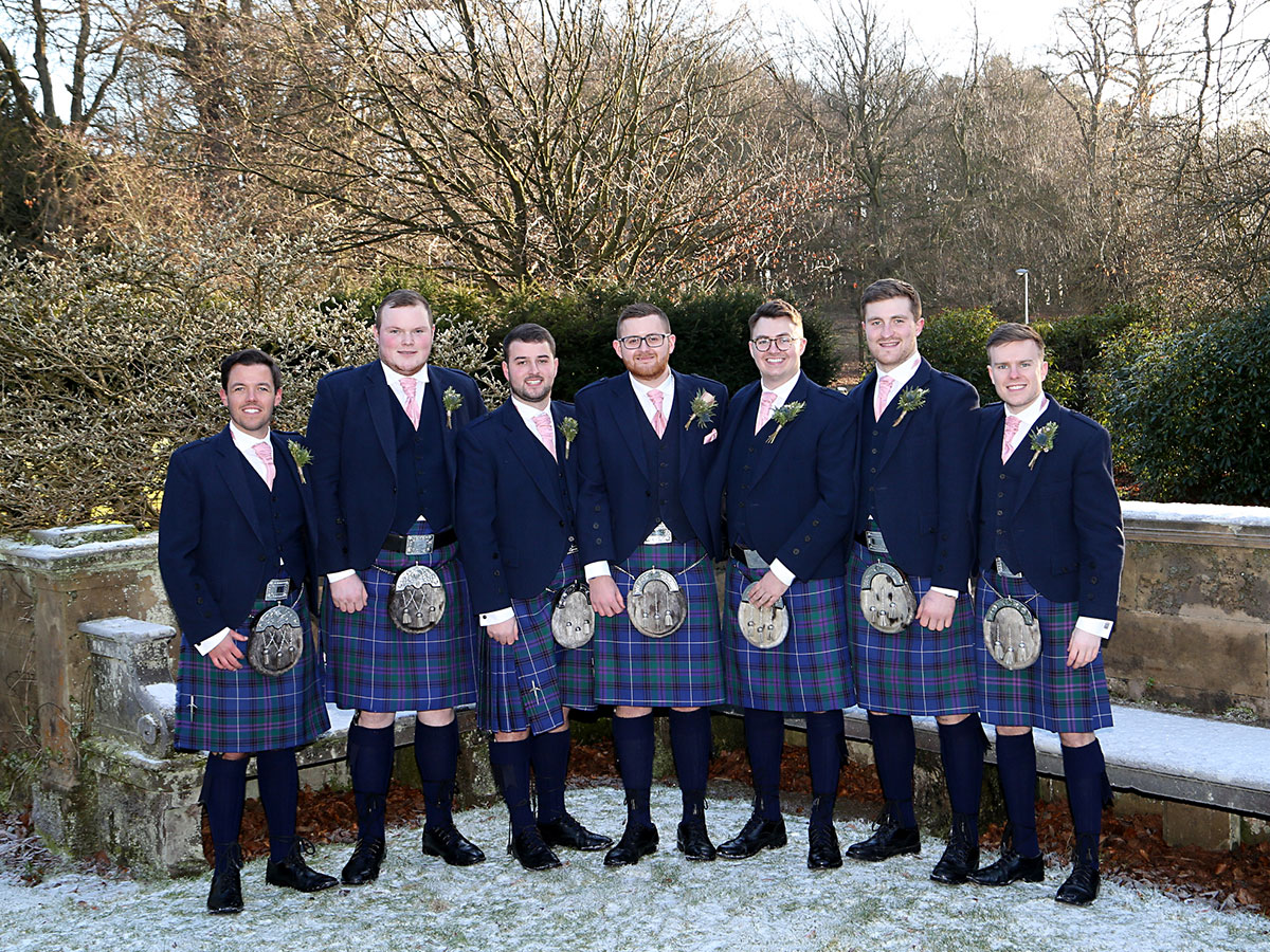 groom-and-groomsmen-in-blue-tweed-kilt-outfits