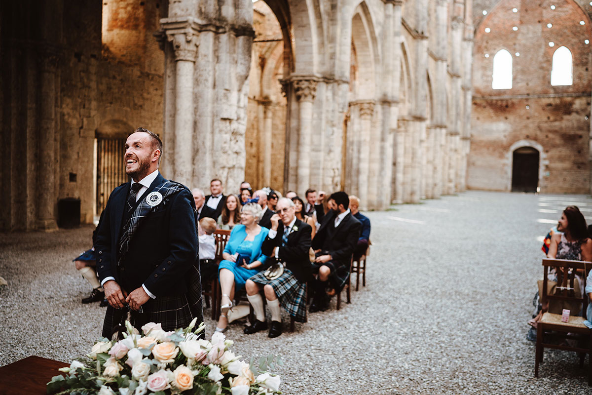 groom-waiting-on-bride-arriving-at-ceremony