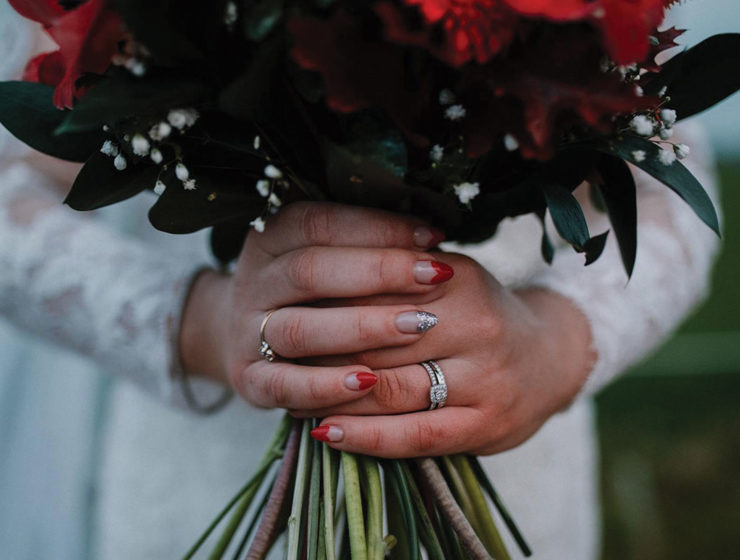 bride-holding-bouquet-with-red-nails