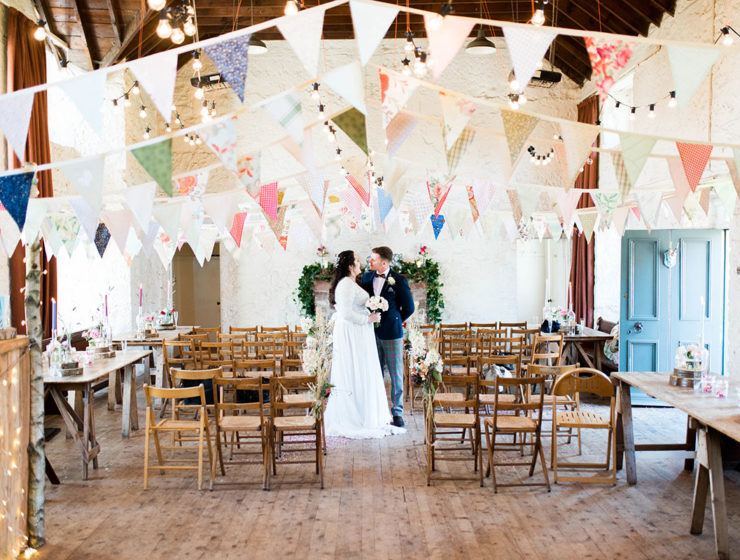 couple-in-village-hall-with-bunting