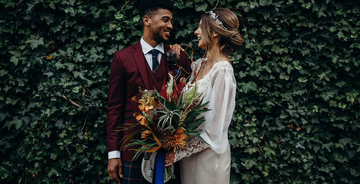 rustic-wedding-shoot-with-bride-and-groom-in-front-of-ivy-wall