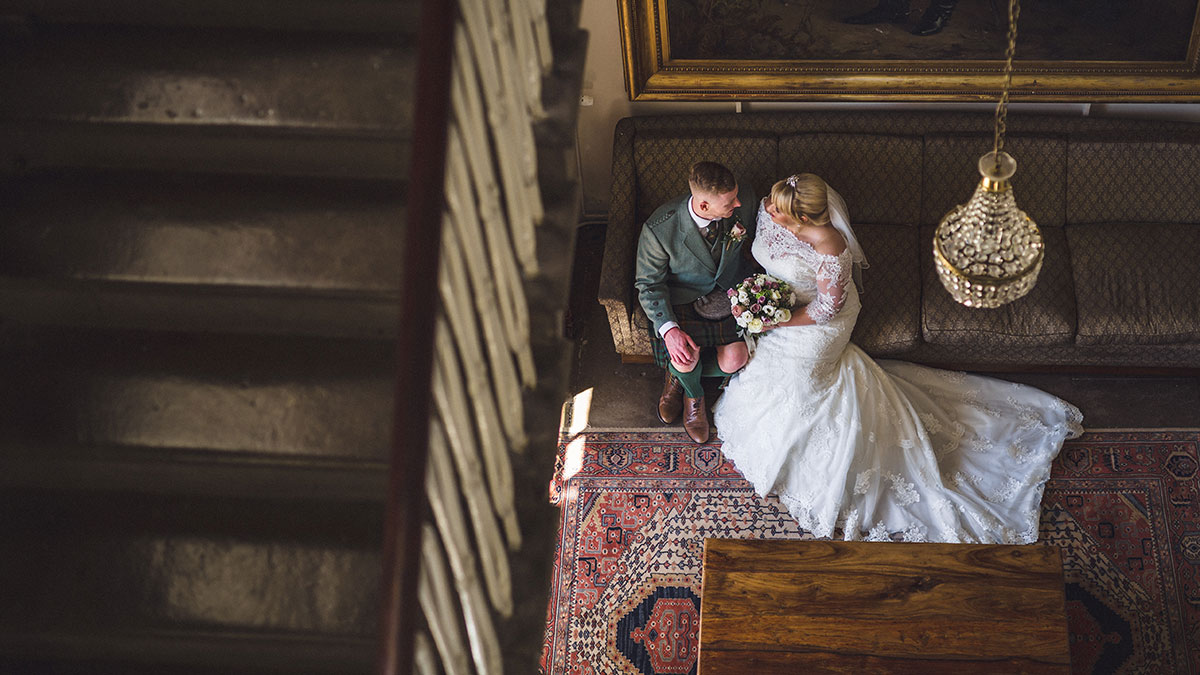 picture-taken-from-above-of-bride-and-groom-talking