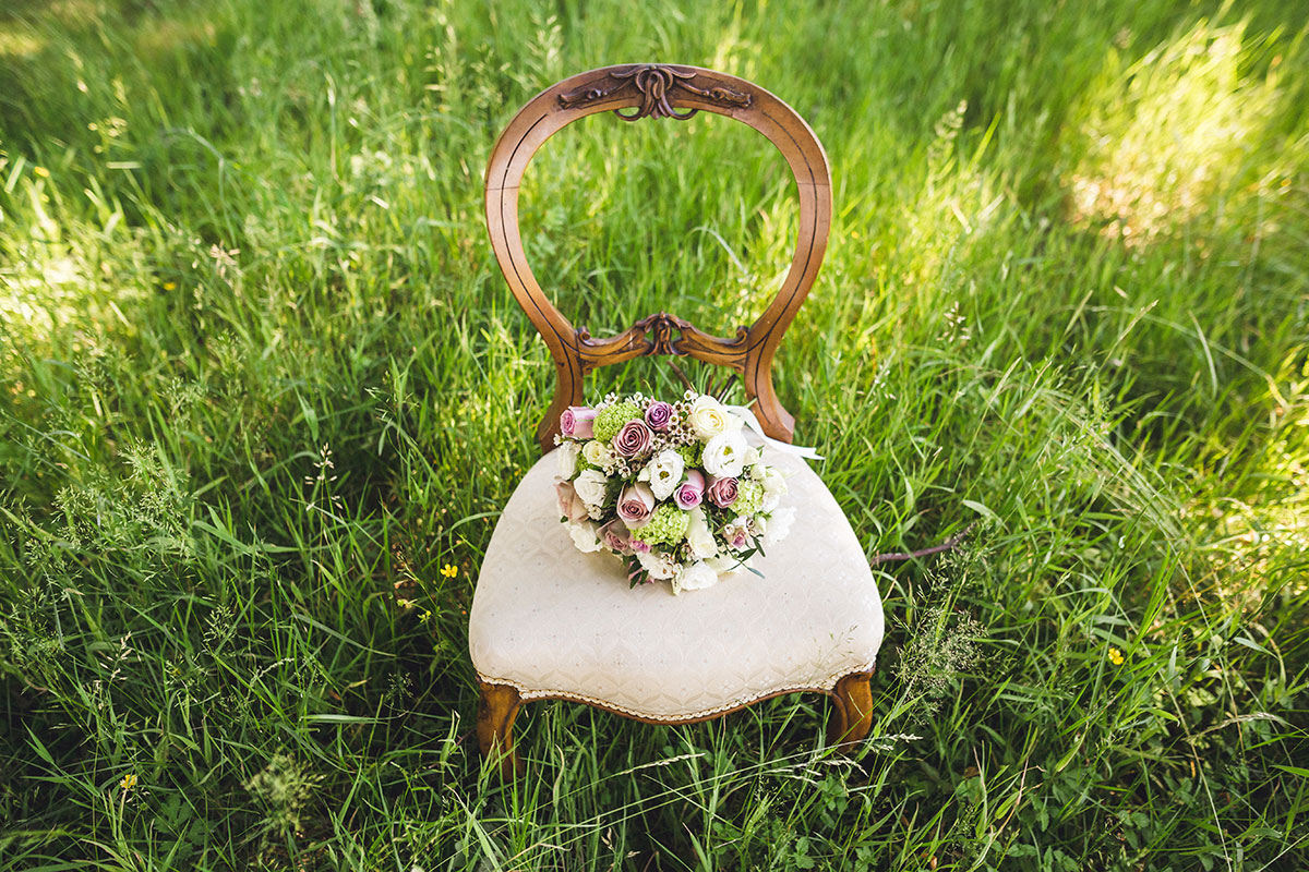 bouquet-of-flowers-on-ornate-chair