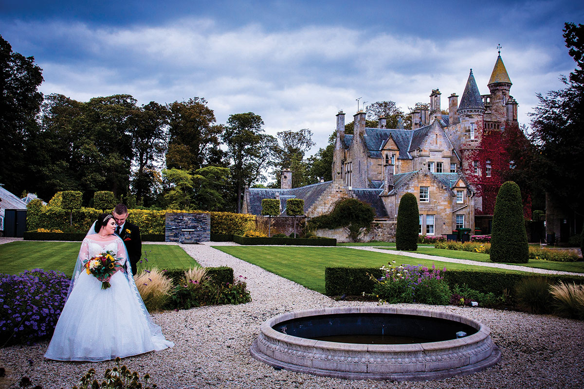 bride-and-groom-outside-carlowrie-castle