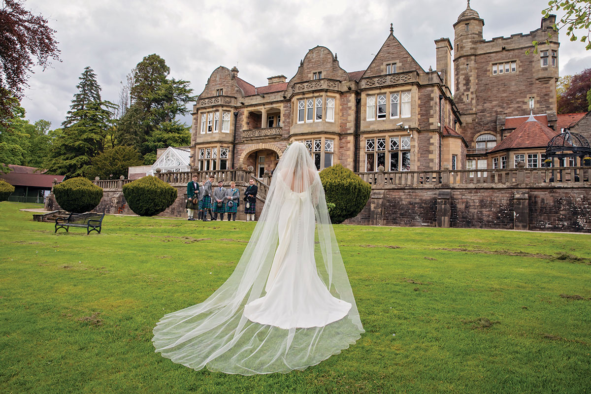 bride-standing-on-lawn-of-inglewood-house