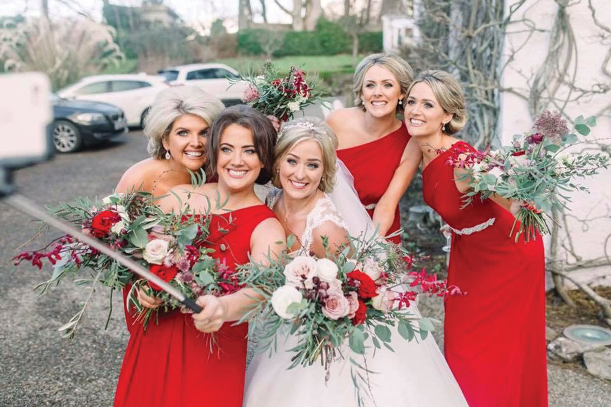 bride-and-bridesmaids-taking-selfies