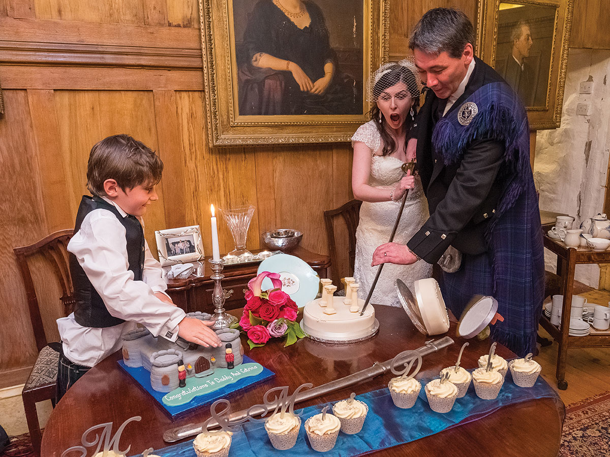 bride-and-groom-cutting-cake-while-it-falls-over