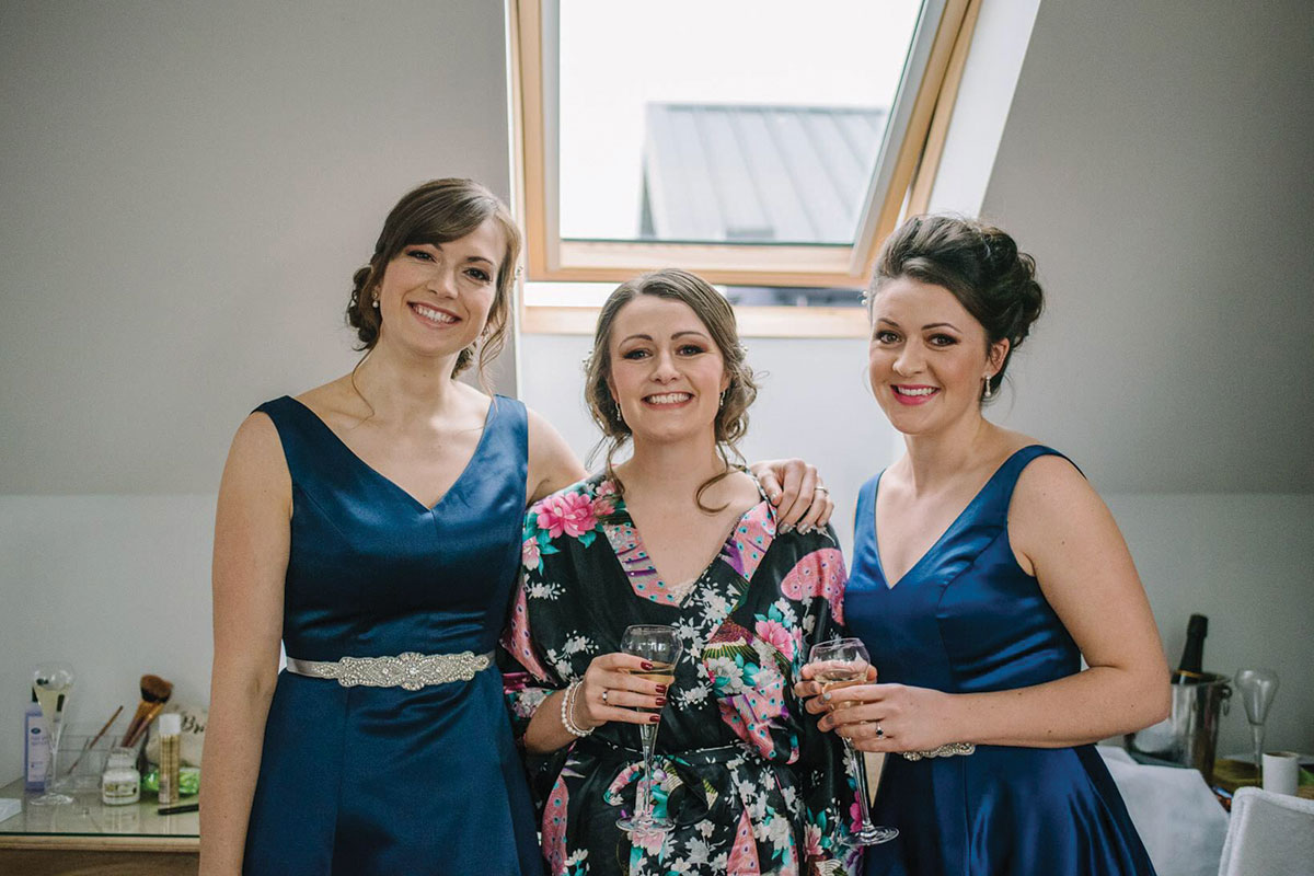 bride-in-oriental-robe-and-bridesmaid-in-blue-dresses
