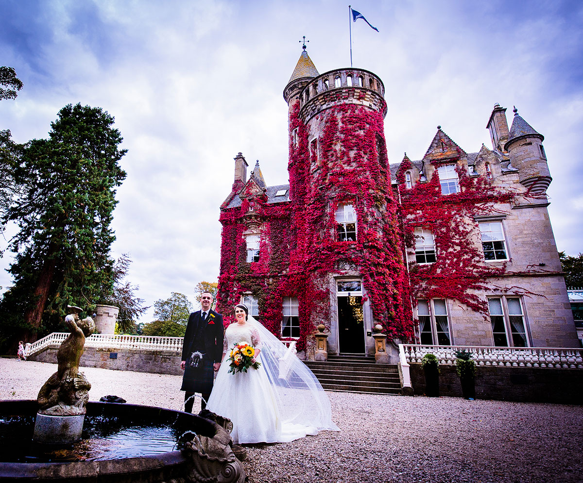 carlowrie-castle-with-bride-and-groom-outside