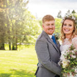 smiling-bride-and-groom-in-the-sunshine