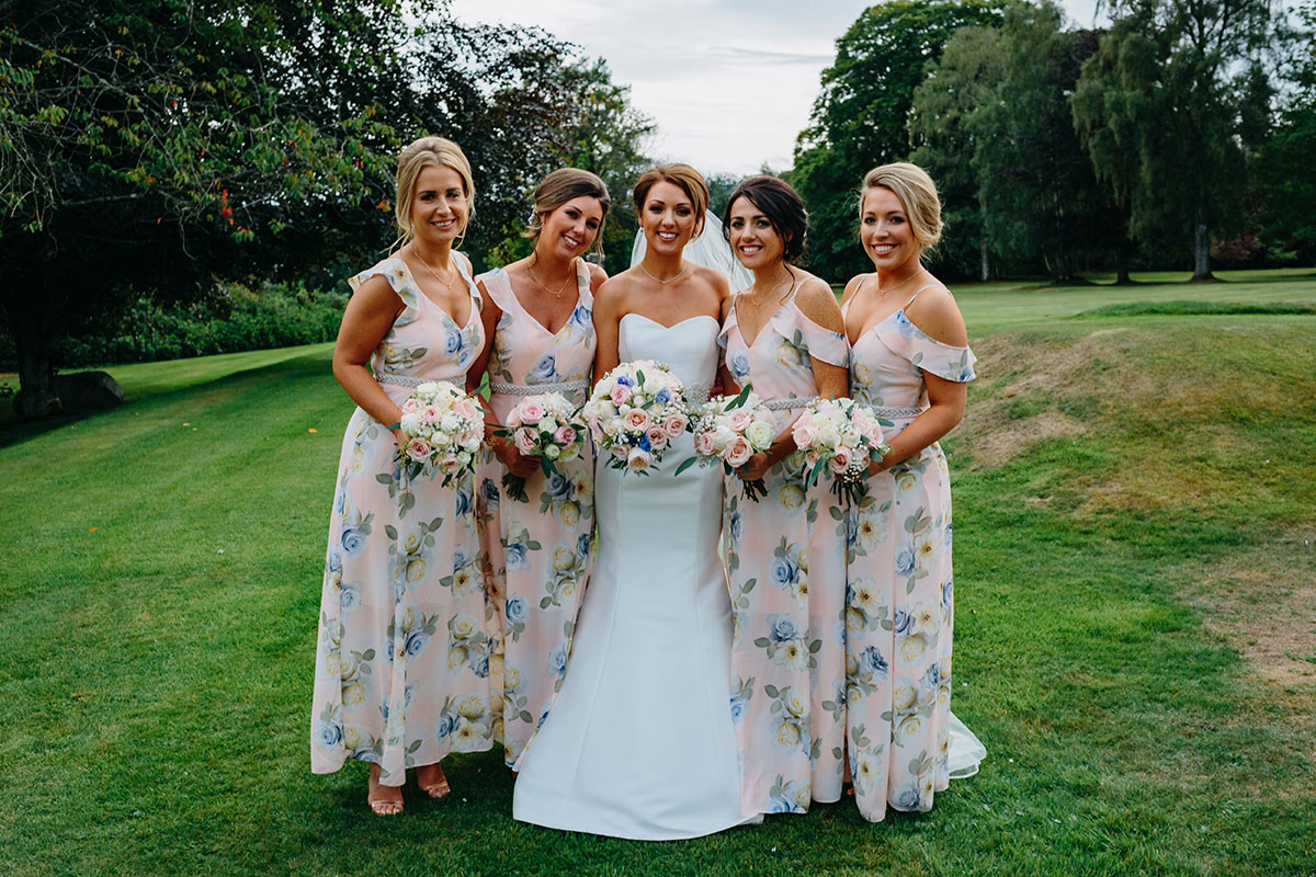 bride-and-bridesmaids-posing-in-the-grounds