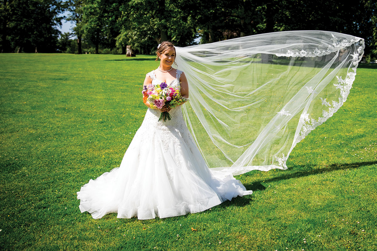 bride-with-veil-trailing-in-the-wind