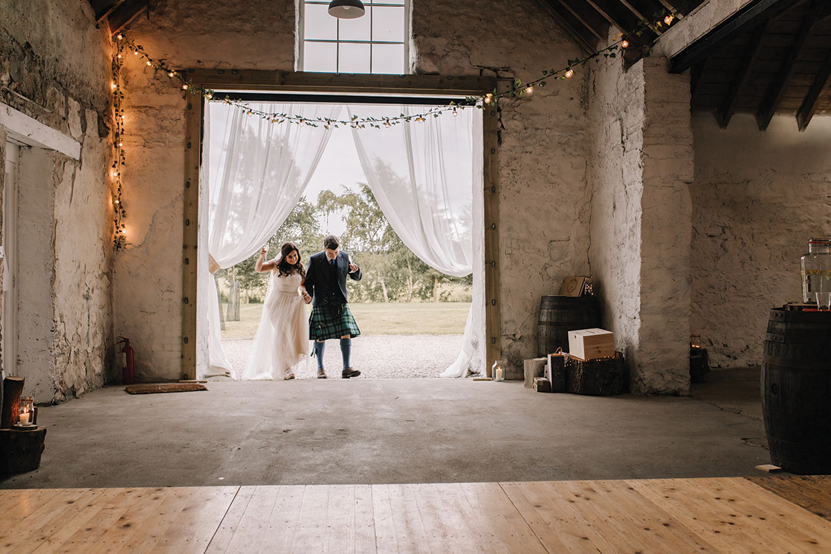 bride-and-groom-entering-The-Barn-at-Easter-Coulnakyle