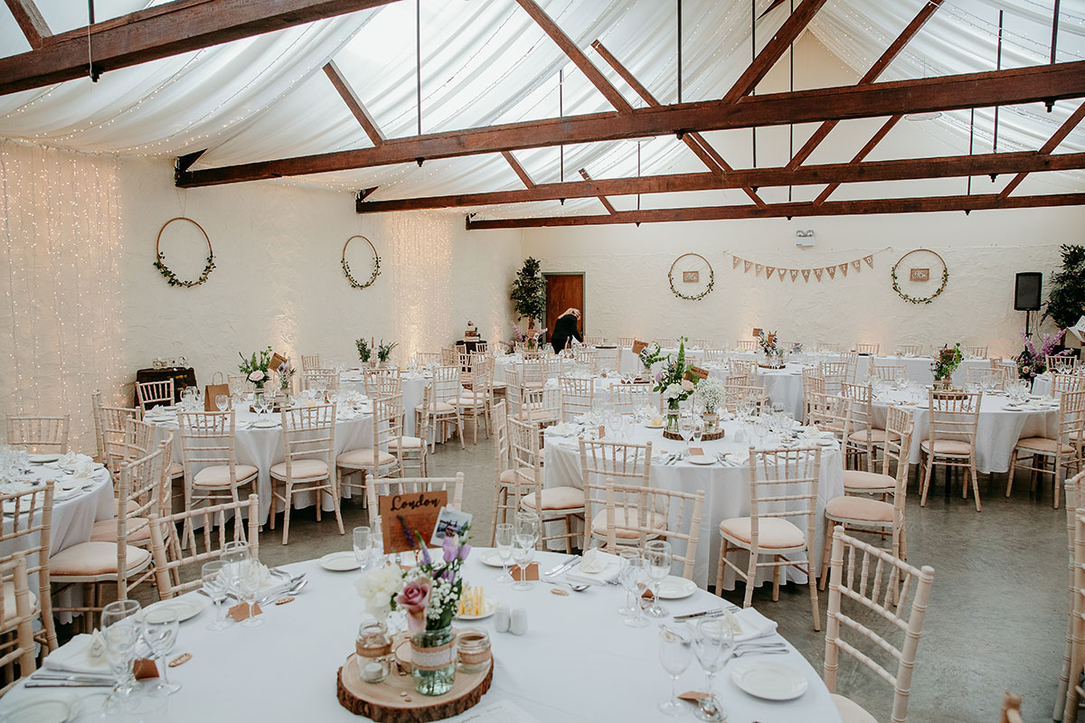 white-barn-with-rustic-decor-set-up-for-wedding-breaskfast