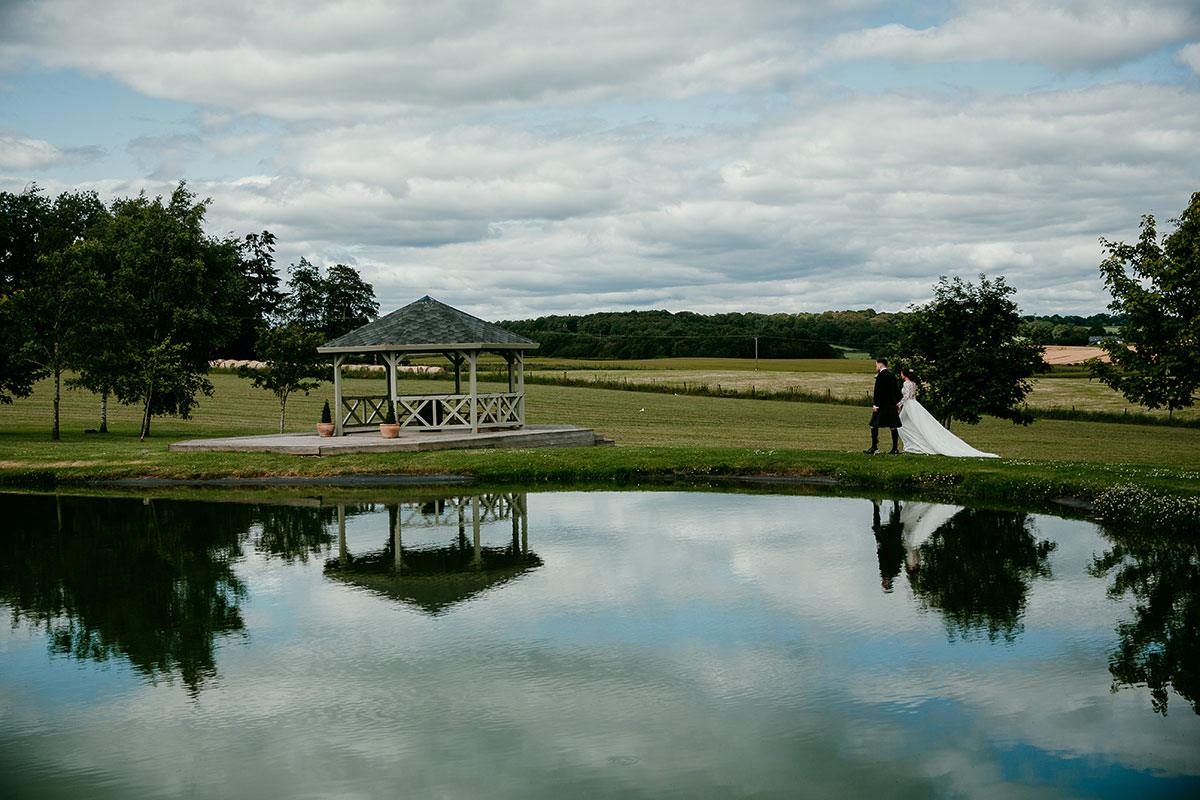 bride-and-groom-walking-by-the-lake