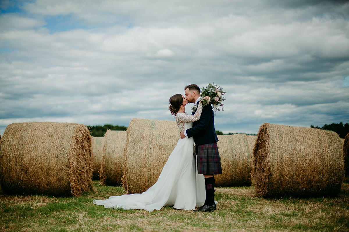 bride-and-groom-in-front-of-hay-bales
