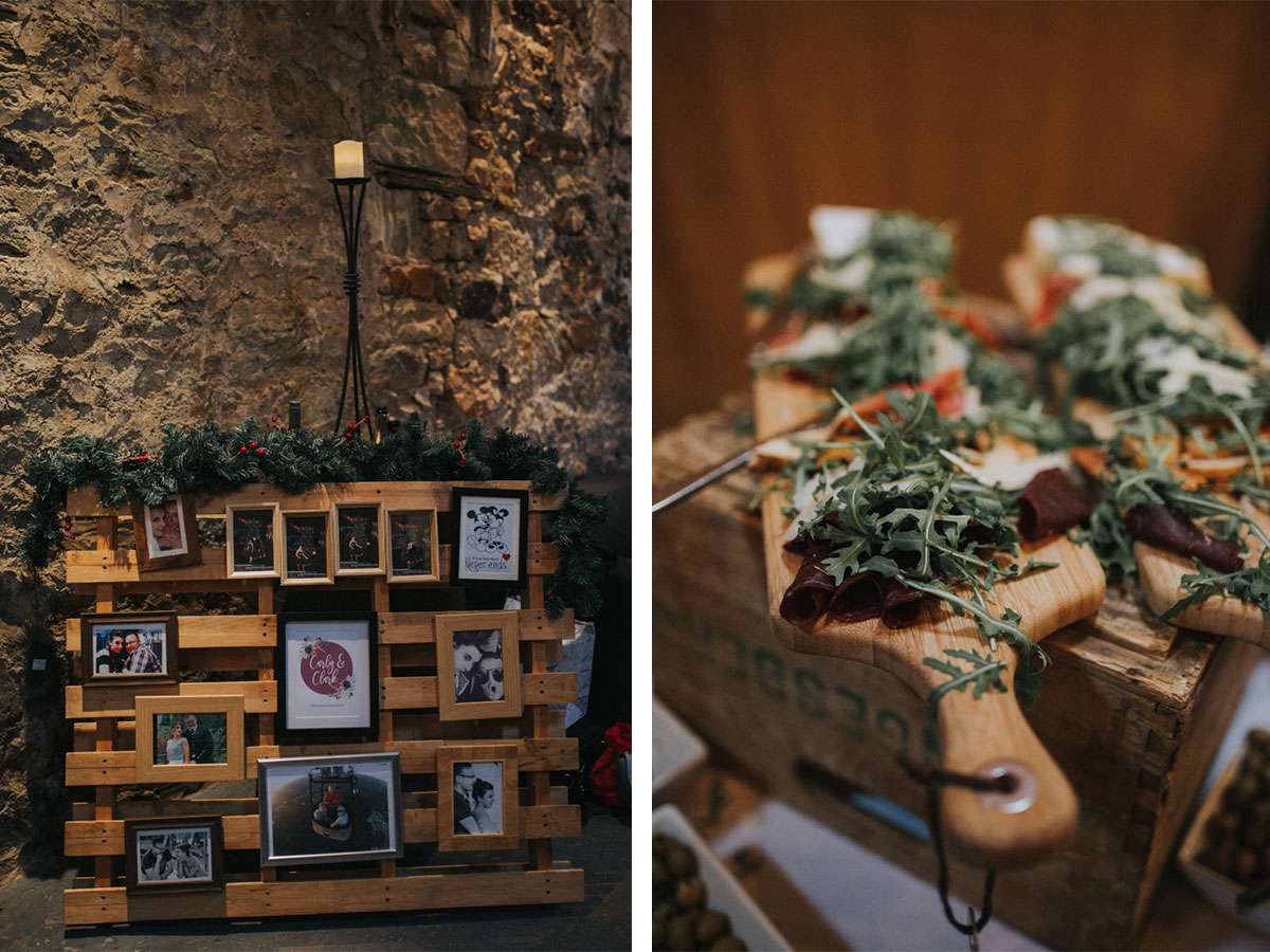 wooden-pallet-with-christmas-garland-and-paddleboards-covered-with-canapes