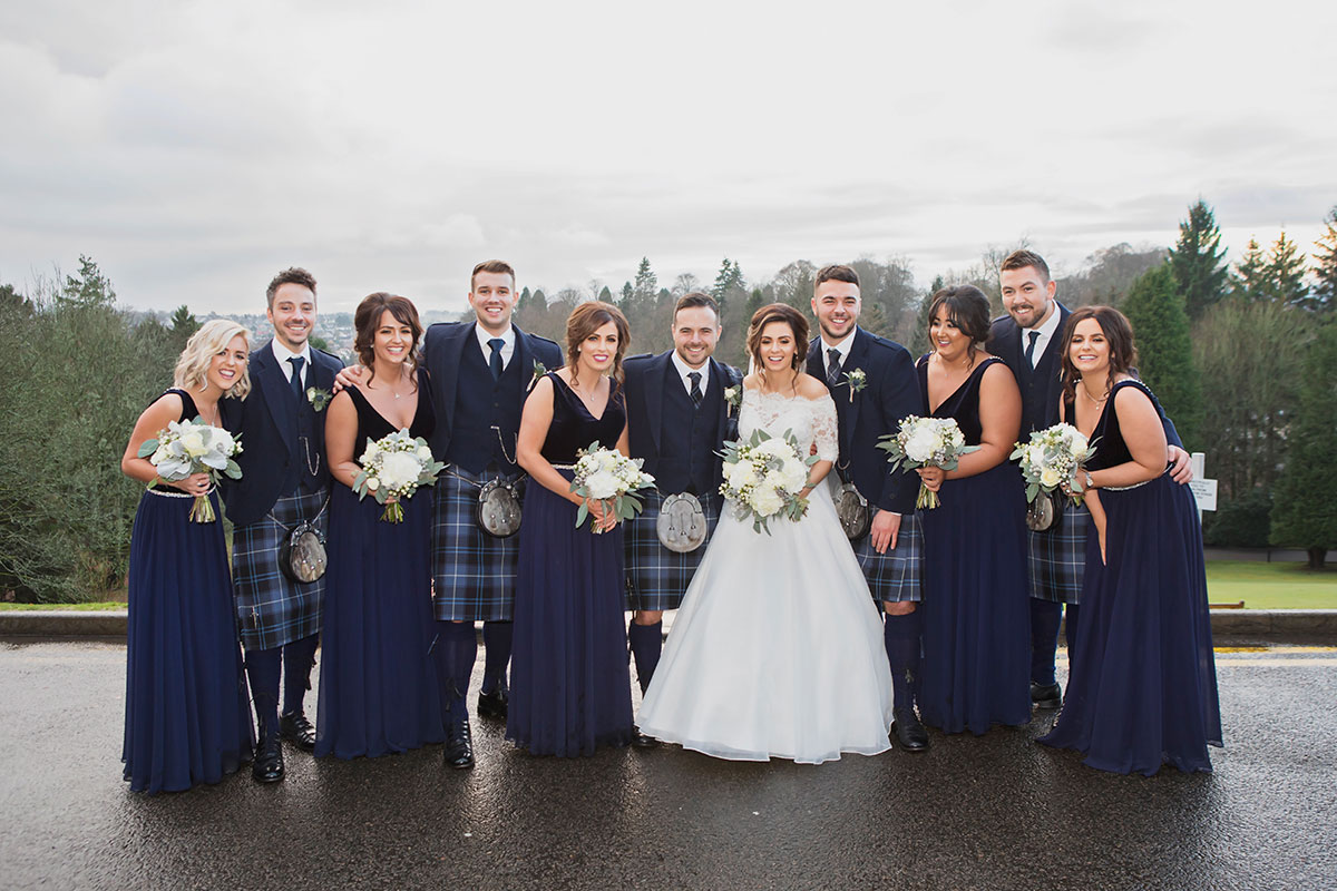bridal-party-in-kilt-outfits-and-navy-bridesmaid-dresses