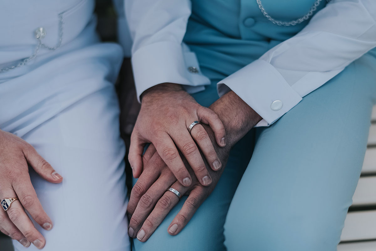 holding-hands-with-wedding-rings-on