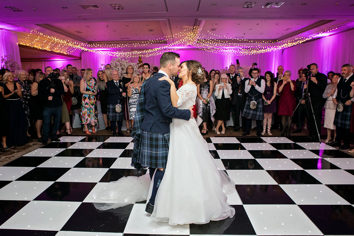 bride-and-groom-kissing-during-first-dance