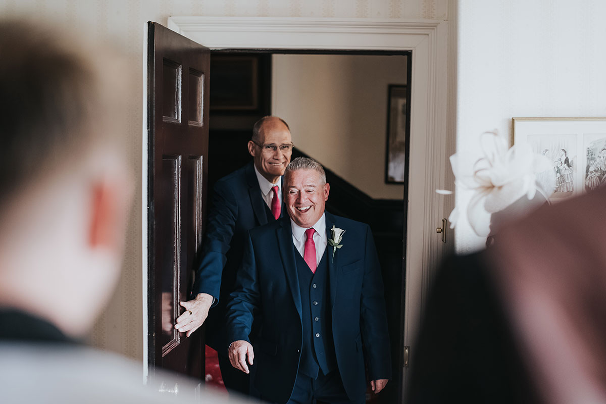 grooms-dads-walking-in-to-get-them-for-ceremony