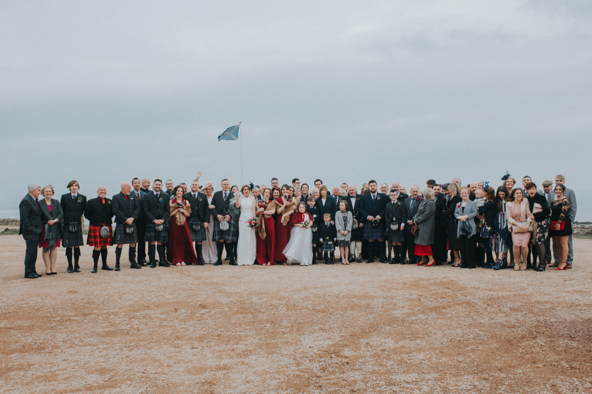 all-guests-on-beach-for-group-shot