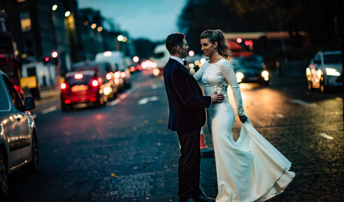 _bride-and-groom-crossing-road-in-dark
